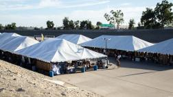 Tents set up in L.A. River channel for SELA Arts Festival.