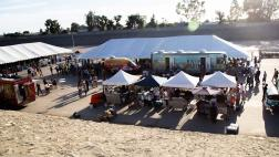 Crowds of visitors walk among tents at SELA Arts Festival.