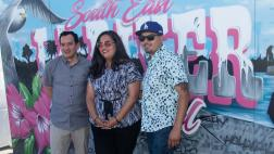 Speaker Anthony Rendon and Assemblymember Wendy Carrillo post in front of mural done by artist, also pictured, Tetris Swai.